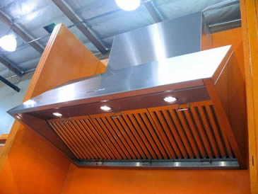 Three stainless steel baffle grease filters are installed at kitchen