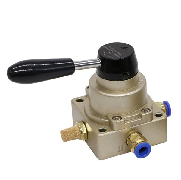 A brass silencer is inserted into a pneumatic switch manual valve.