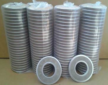 Many toroidal shape filter discs packed with plastic bags