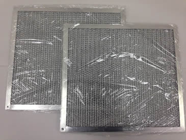 Two aluminum honeycomb grease filters are packed with plastic cloth